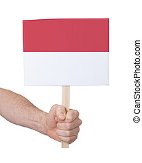 Hand holding small card - Flag of Indonesia