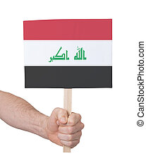 Hand holding small card - Flag of Iraq