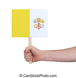 Hand holding small card - Flag of Vatican City