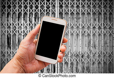 Hand holding smart phone with blur background