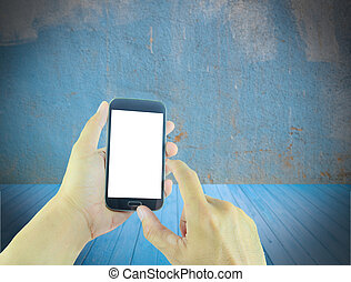 Hand holding smart phone with blurred grunge background