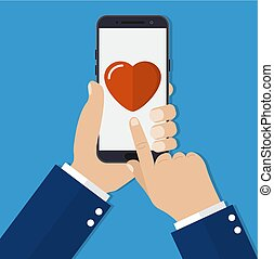 Hand holding smartphone heart on the screen.