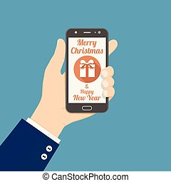 Hand holding smartphone with Christmas gift icon on screen
