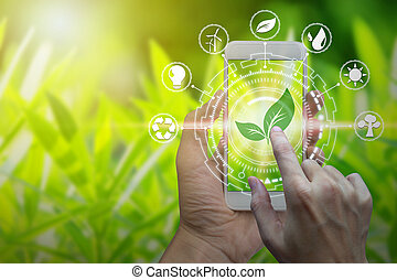 Hand holding smartphone with environment Icons