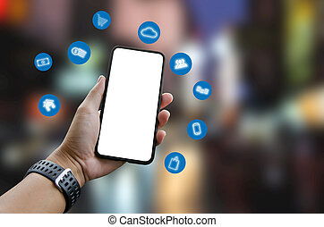 Hand holding smartphone with icons
