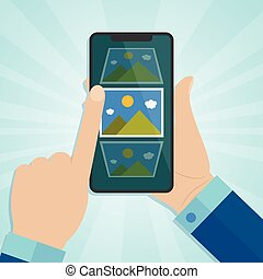Hand holding smartphone with photo icons on a screen