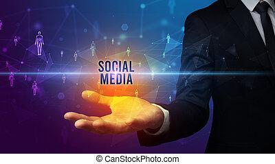 Hand holding social media related inscription