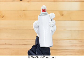 Hand holding spray paint can