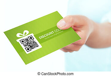 hand holding spring discount card isolated over white...