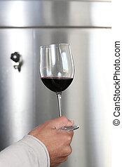 hand holding stemmed glass