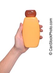 Hand holding sun lotion - man hand holding sun lotion bottle...