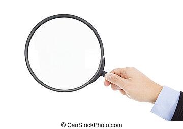 hand holding super big magnifier glass