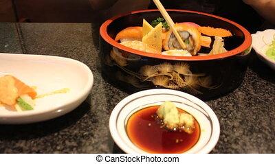 Hand Holding Sushi Using Chopsticks, Stock Video