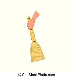 Hand holding sweeping broom, besom, human hand with tool for...