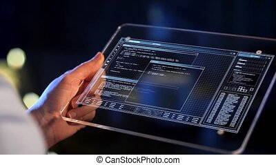 hand holding tablet pc with coding on screen - technology,...