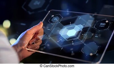 hand holding tablet pc with virtual projections -...
