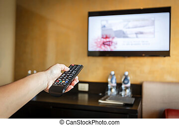 Hand holding Television remote control