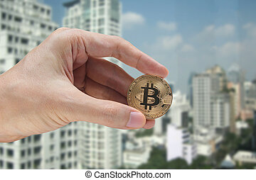 hand holding the bitcoin and blockchain network connection ...