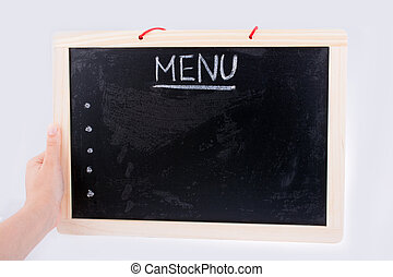 Hand holding the board with the title of menu