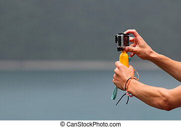 Hand holding the camera with handle