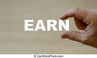 Hand holding the word EARN