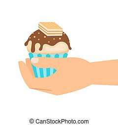 Hand holding wafer cupcake
