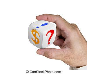 hand holding white dice