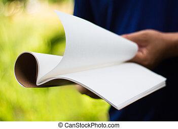 holding white journal