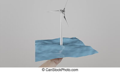 Hand holding wind generator located on water. Engineering and maintenance concept. Ecologic power generation. 4K clip