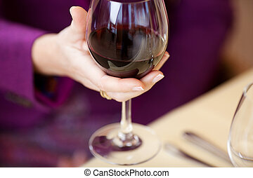 Hand Holding Wine Glass At Restaurant Table - Selective...
