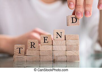Hand Holding Wooden Block From Word Trend