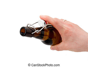 Hand holds a bottle of beer. Isolated on white background