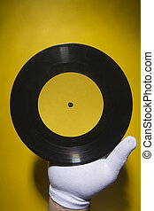 Hand holds a vinyl record