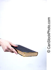 Hand holds an old book