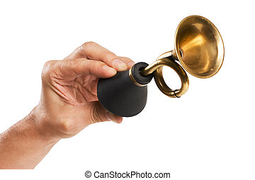 hand holds an old car horn