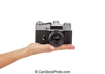 Hand holds an old photo camera, isolated
