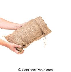 Hand holds bag