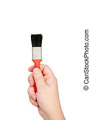 Hand holds brush isolated on white background.