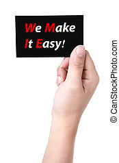Hand holds business card  with WE MAKE IT EASY! message