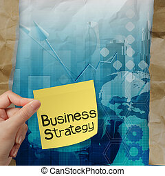 hand holds business strategy with sticky note on crumpled paper with tear envelope as concept