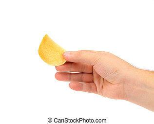 Hand holds chip of potato.