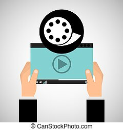 hand holds digital player film reel