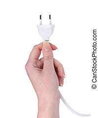 Hand holds electric plug.
