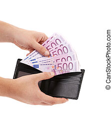 Hand holds five hundred euro from purse.