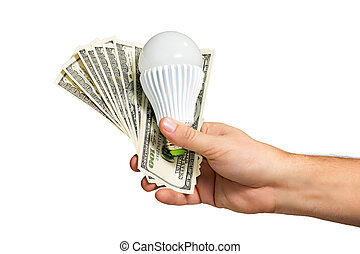 Hand holds money and lamp