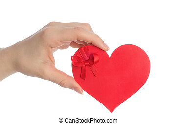 Hand holds paper heart with bow on white background