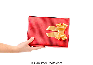 Hand holds red box with gold bow.