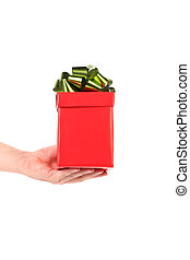 Hand holds red box with green-golden bow.