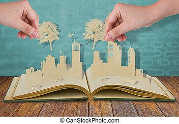 hand, houden, papier, knippen, van, boompje, op, papier, knippen, van, steden, met, auto, en, schaaf, op, oud, boek