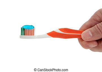 hand houdend, een, sinaasappel, tandenborstel, op, een, witte achtergrond